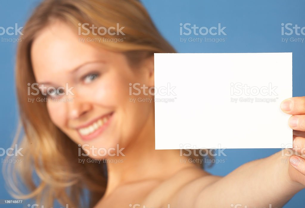 Sexy young woman showing business card royalty-free stock photo