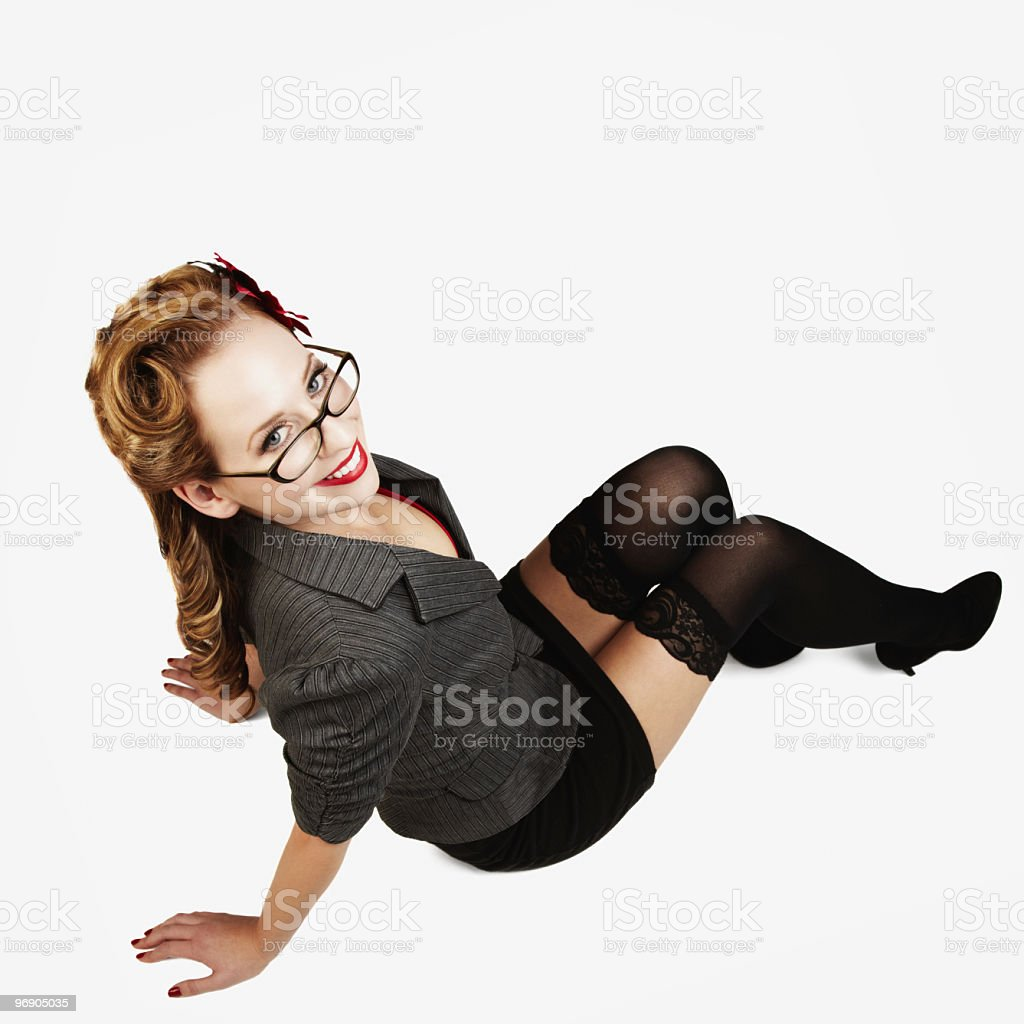 Sexy Young Woman Sitting and Smiling. Isolated royalty-free stock photo
