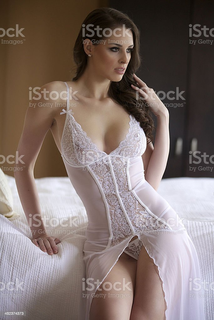 Sexy Young Woman Standing Beside a bed royalty-free stock photo