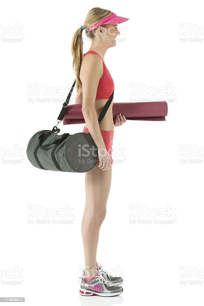 Sexy young woman with sports bag and yoga mat royalty-free stock photo