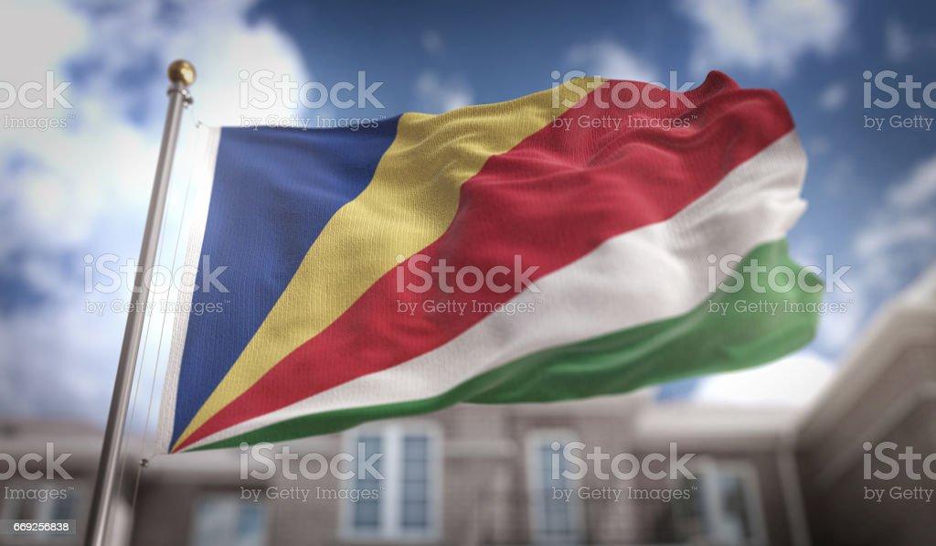 Seychelles Flag 3D Rendering on Blue Sky Building Background stock photo