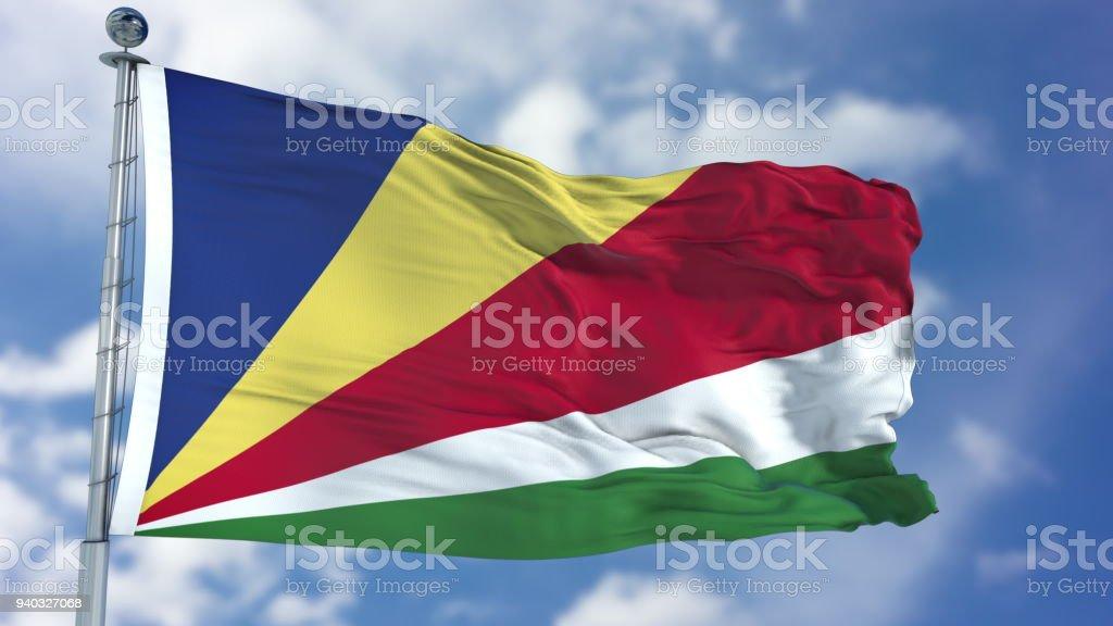 Seychelles Flag in a Blue Sky stock photo