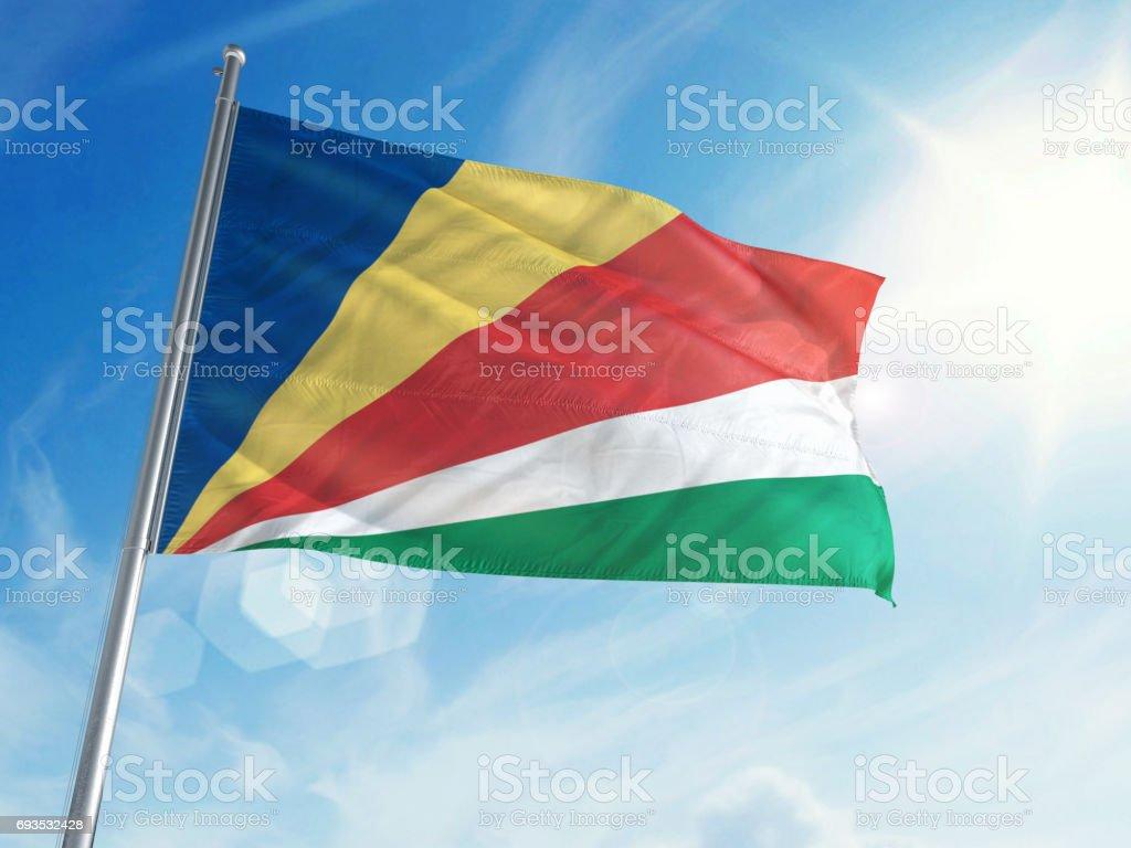 Seychelles Flag on a Cloud Background stock photo
