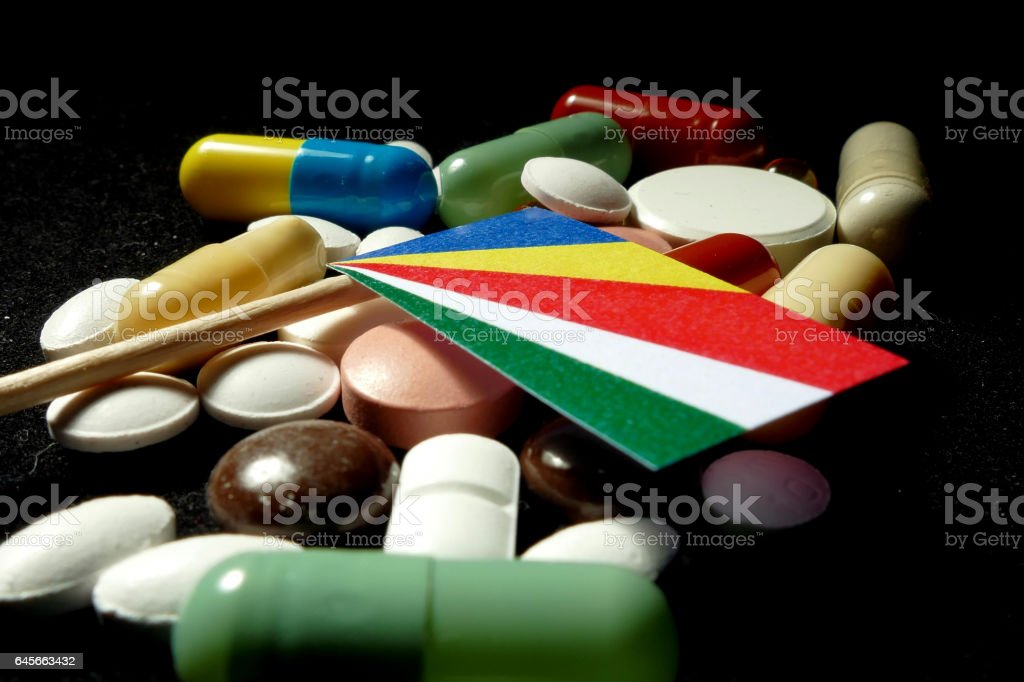 Seychelles flag with lot of medical pills isolated stock photo