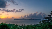 Seychelles, La Digue at sunset. Landscape with sky and colorful clouds. Sun at twilight on the calm sea on the horizon. View of Praslin island