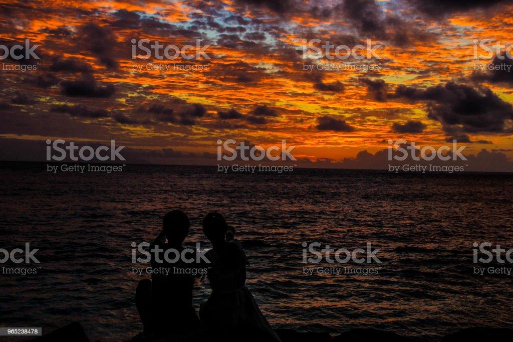 Seychelles Praslin Castello Beach Sunset Couple silhouette zbiór zdjęć royalty-free