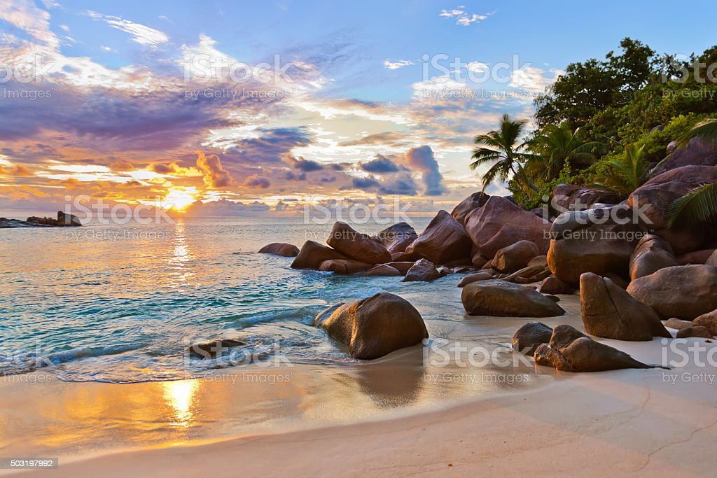Seychelles tropical beach at sunset stock photo