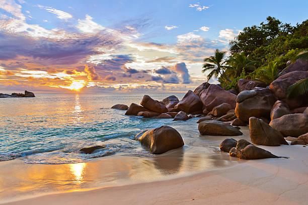 Seychelles tropical beach at sunset stock photo