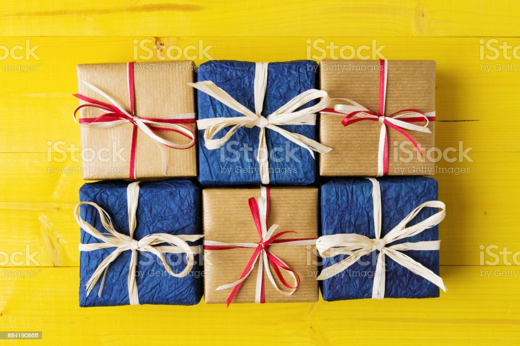Sguare Gift Boxes On Yellow Planks Stock Photo Download Image Now