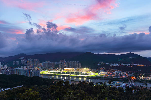 Sha Tin Racecourse Hong Kong Sha Tin Racecourse is one of the two racecourses for horse racing in Hong Kong. It is located in Sha Tin in the New Territories. It is managed by Hong Kong Jockey Club  sha tin stock pictures, royalty-free photos & images