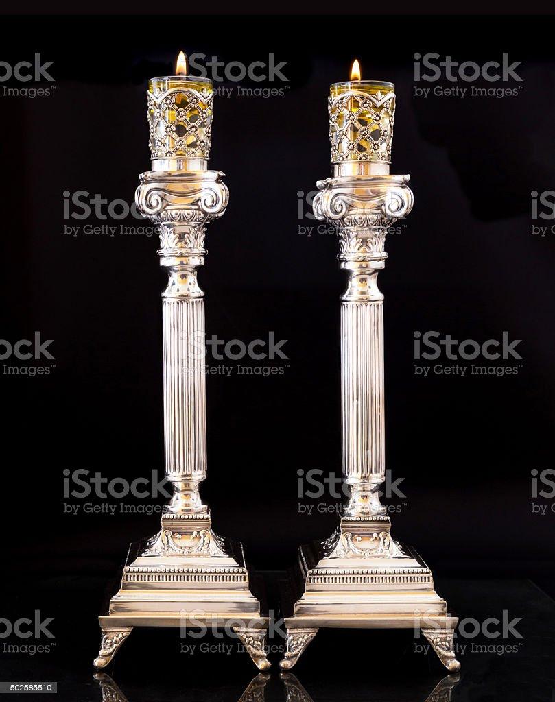 Shabbat candles. Silver candlesticks with olive oil stock photo