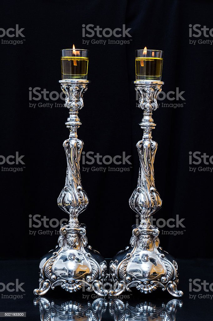 Shabbat candles With olive oil stock photo