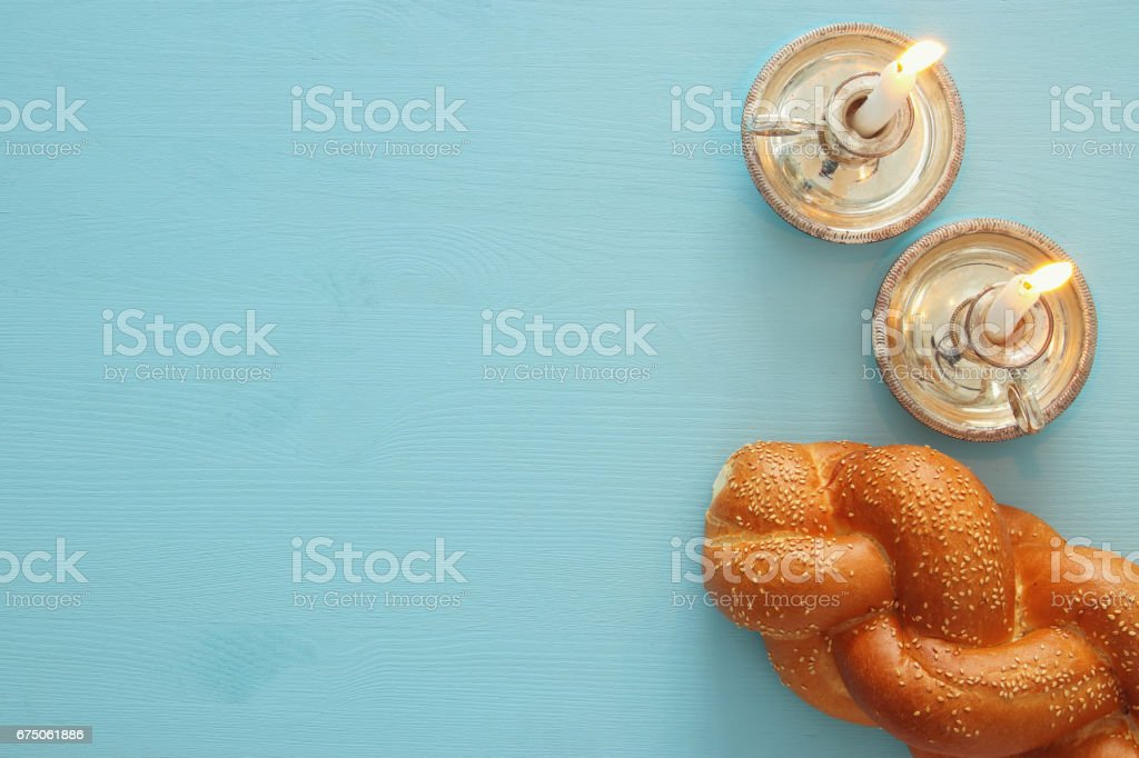 shabbat image. challah bread and candles stock photo