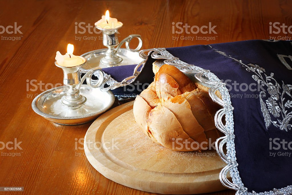 shabbat image. challah bread, shabbat wine and candelas on woode stock photo