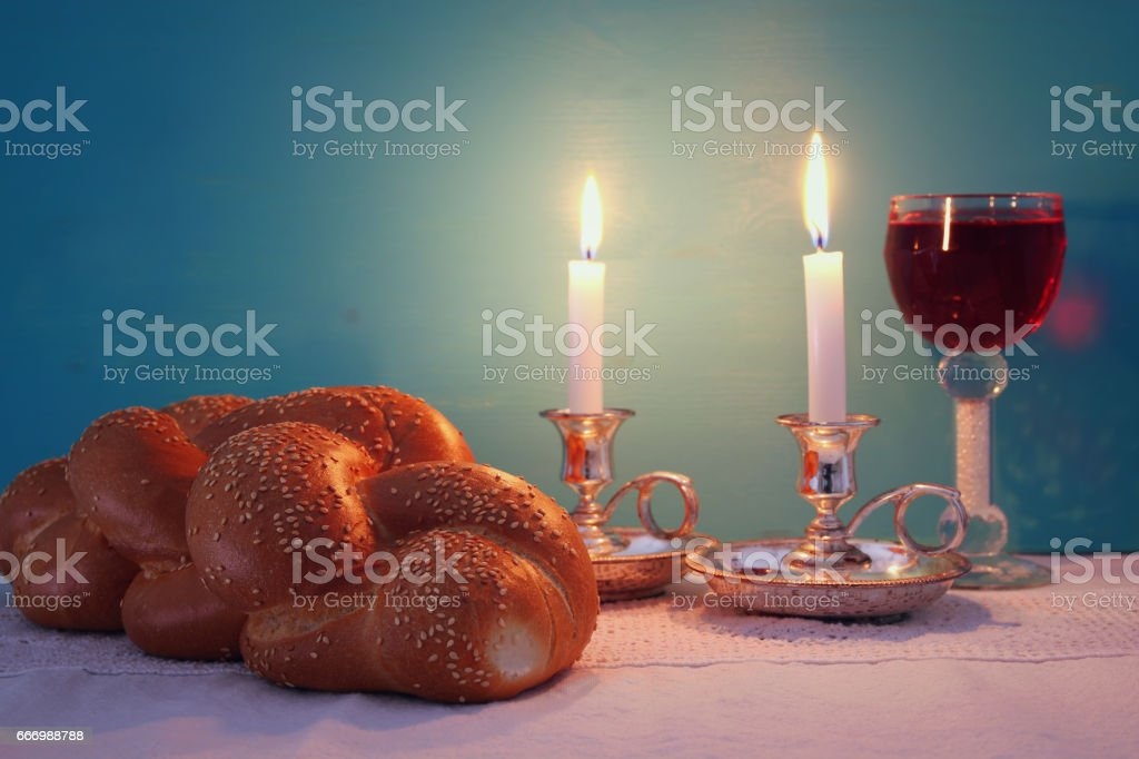 shabbat image. challah bread, shabbat wine and candelas stock photo