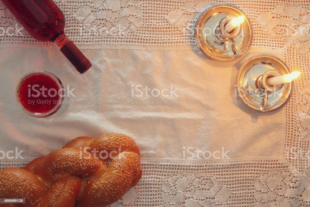 shabbat image. challah bread, shabbat wine and candles stock photo