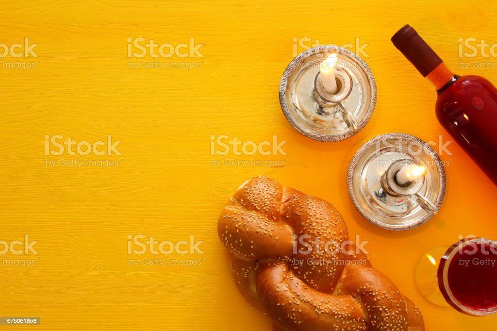 shabbat image. challah bread, wine and candles stock photo