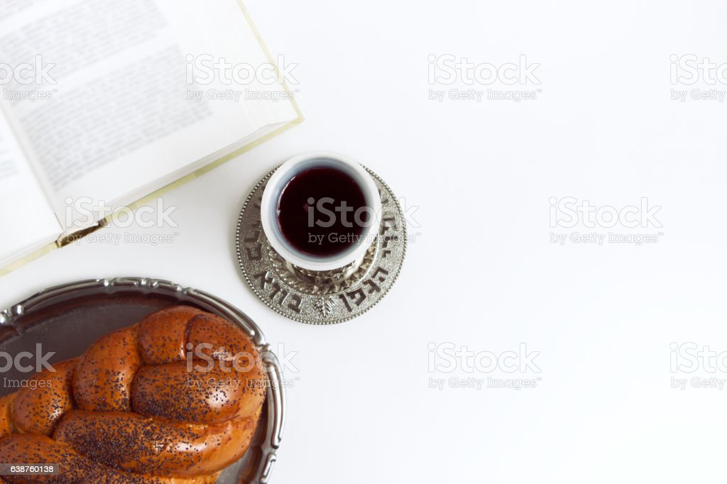 Shabbat Shalom, challah with glass of wine on white background. stock photo