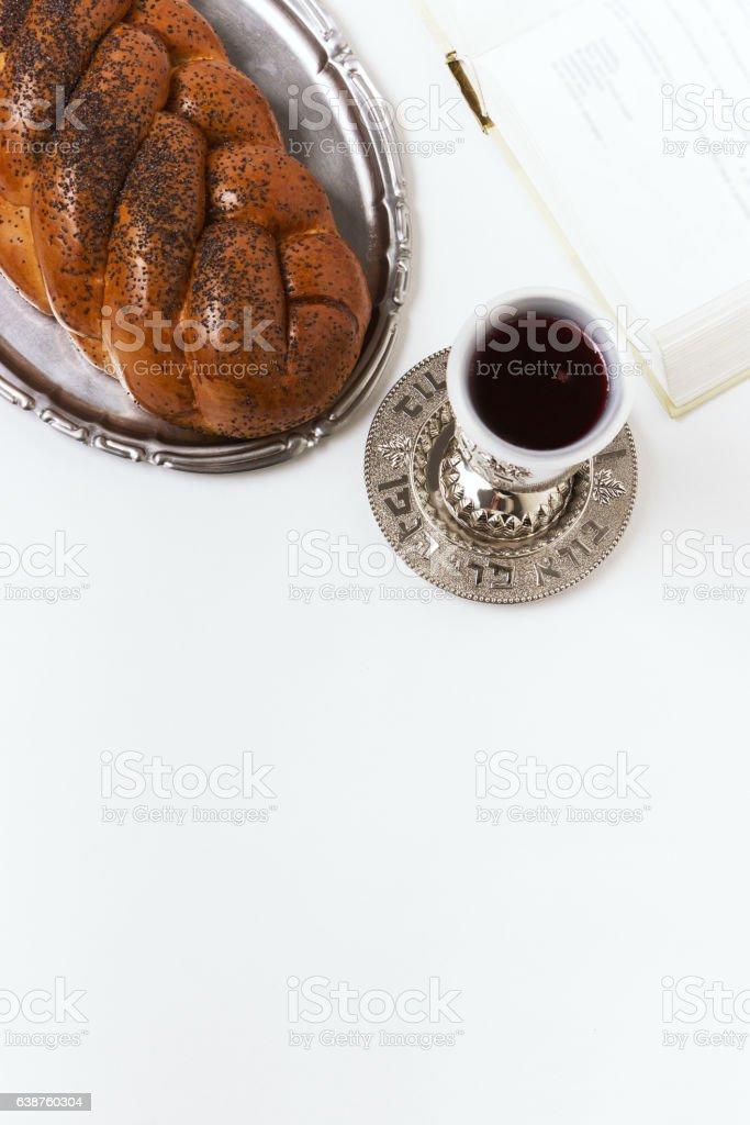 Shabbat Shalom, challah with glass of wine on white background. stock photo