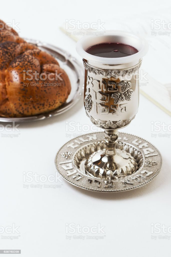 Shabbat shalom, challah with kiddush of wine on white background. stock photo