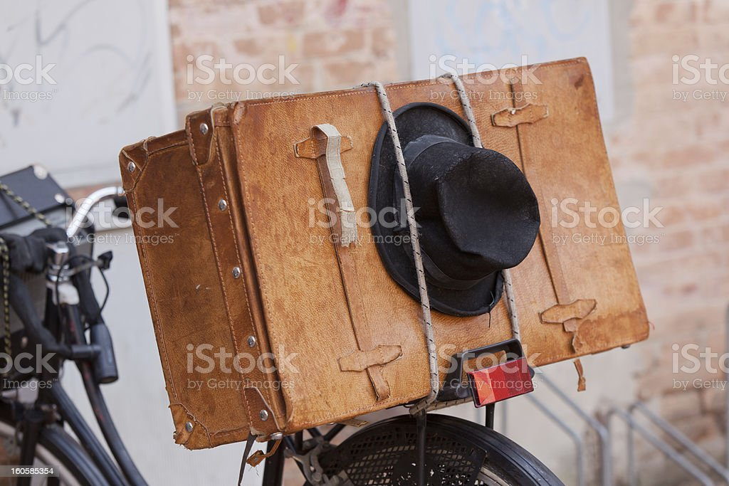 Shabby Black Hat and Brown Suitcase. royalty-free stock photo