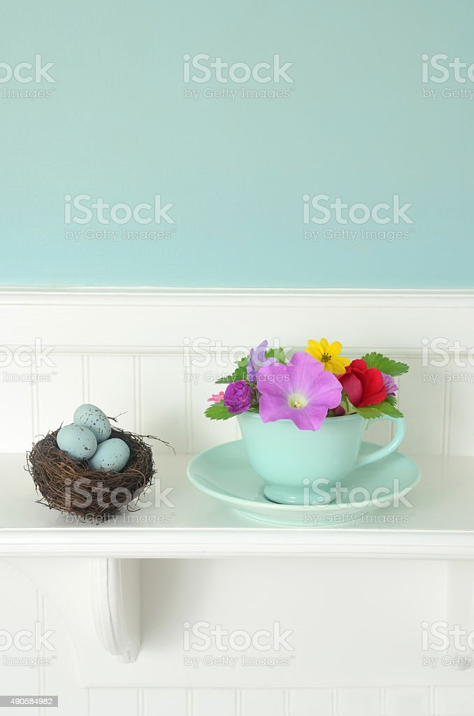 Shabby Chic Tea Cup with Flowers and Bird Nest stock photo