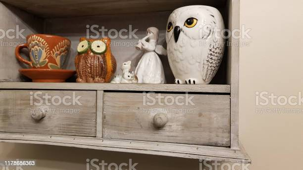 Shabby Chic Wooden Kitchen Wall Cabinet With Authentic Porcelain Utensils In Ethnic Style Crockery Inside Grey Wooden Distressed Shelves Kitchen Interior Stock Photo Download Image Now Istock