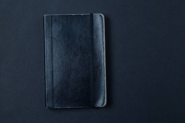 shabby classic notebook on a dark background stock photo