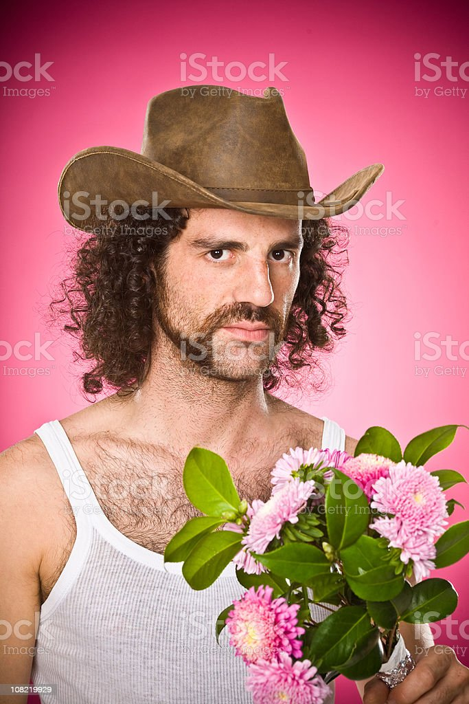 shabby cowboy parody portrait on pink stock photo