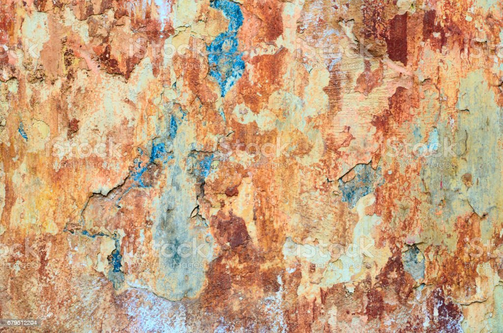 Shabby grunge texture of a stucco coated plaster wall with many layers of paint royalty-free stock photo