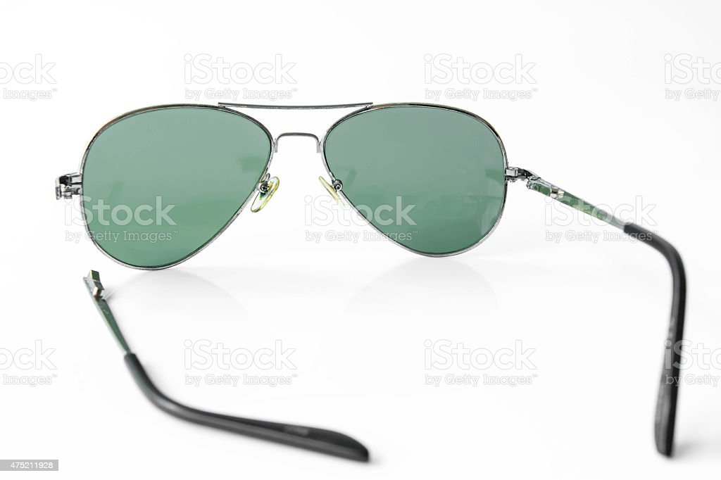 Shabby old sunglasses on white background stock photo