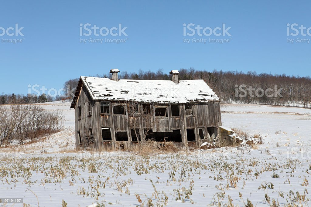 Shabby Weathered Cupola Barn in Snow royalty-free stock photo