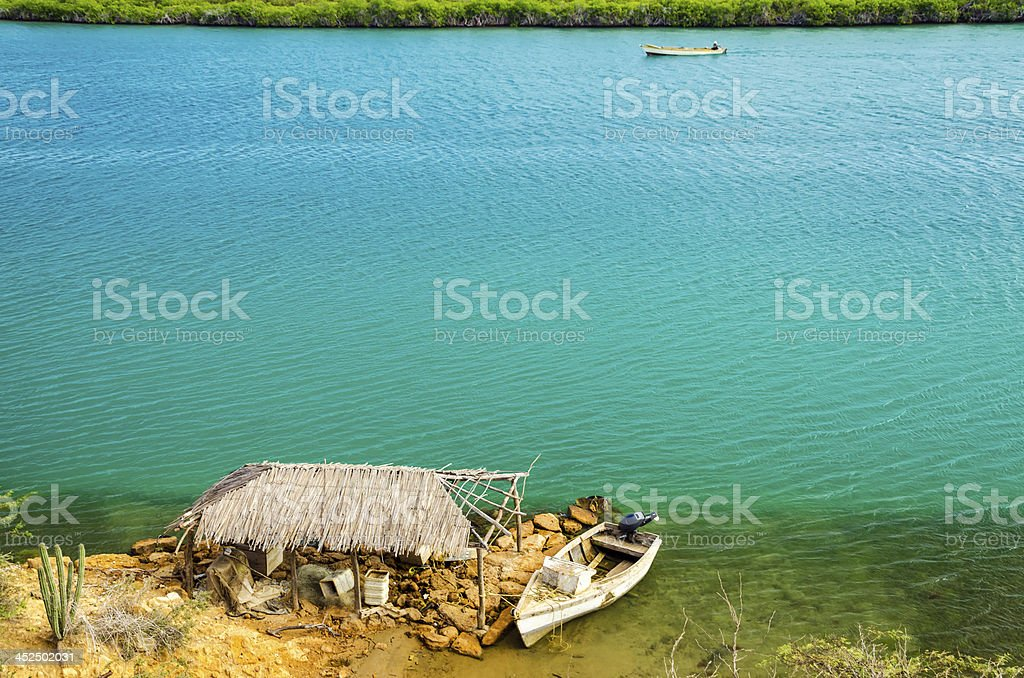 Shack and Blue Water stock photo