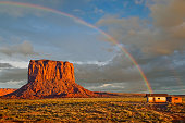 Monument Valley on the Arizona/Utah border epitomizes the essence of the Old West. This colorful rainbow appeared to touch down on a shack near Mitchell Butte.