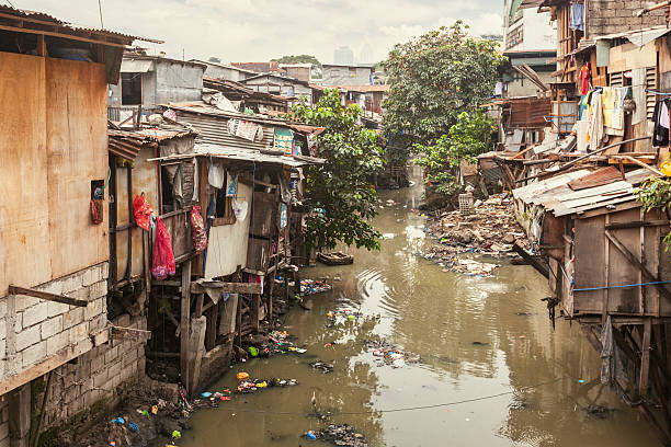 Shacks along a polluted canal stock photo