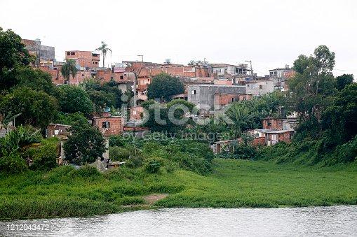 slum in forest area and river in Sao Paulo, Brazil