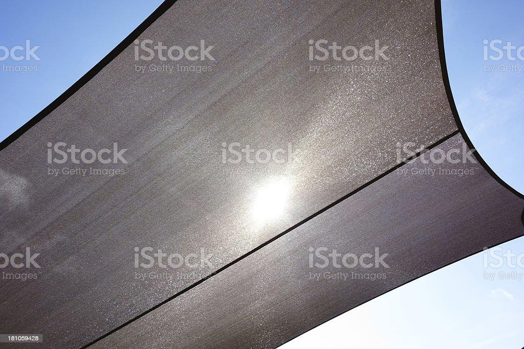 Shade canopy blocking strong direct sunlight stock photo
