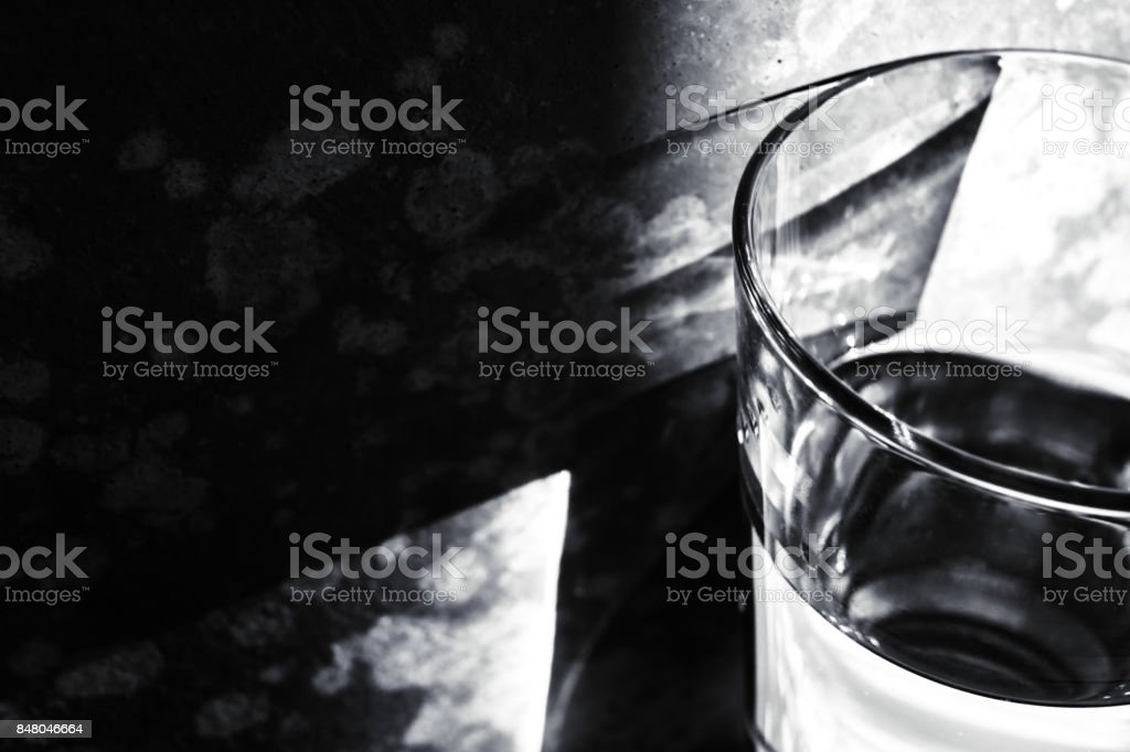 Shade of a glass of water on the wall stock photo