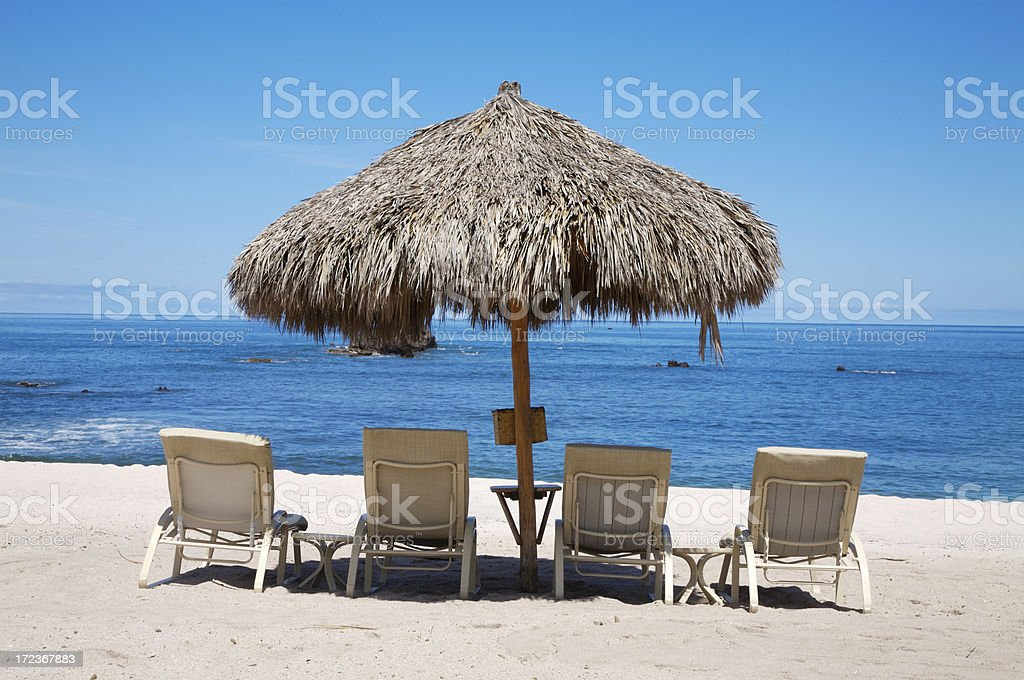 Shade under the sun in white sand beach royalty-free stock photo