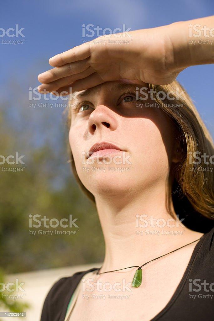 Shading her eyes stock photo