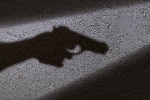 istock Shadow and gun 871380072