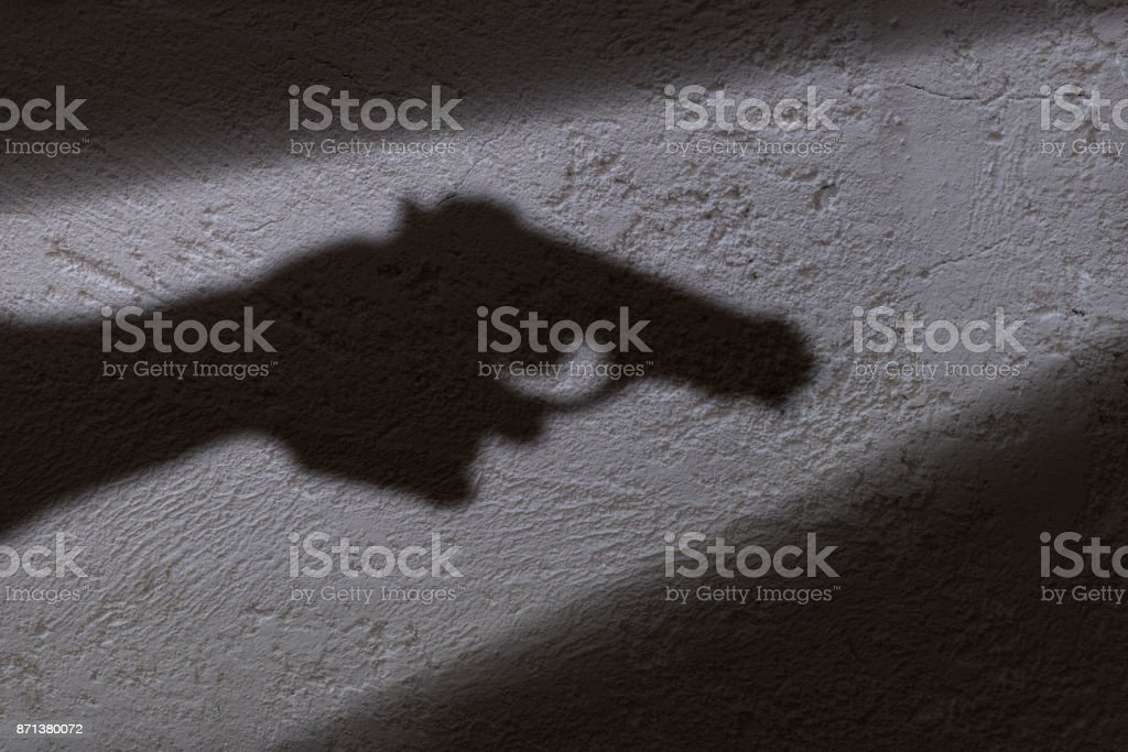 Shadow and gun stock photo