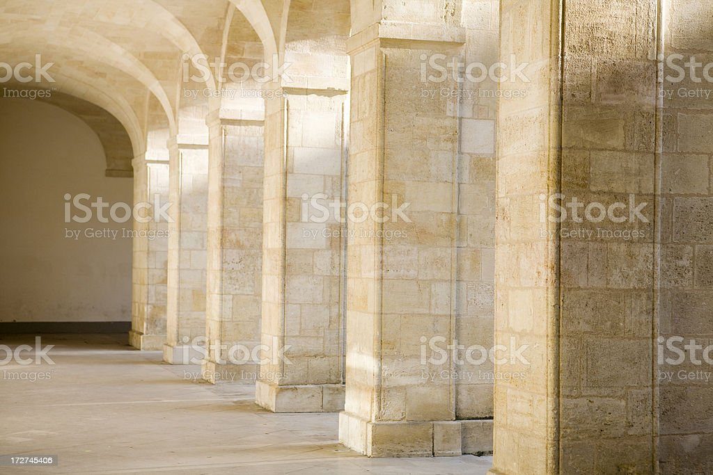 Shadow and light beams on old Arches in Paris royalty-free stock photo
