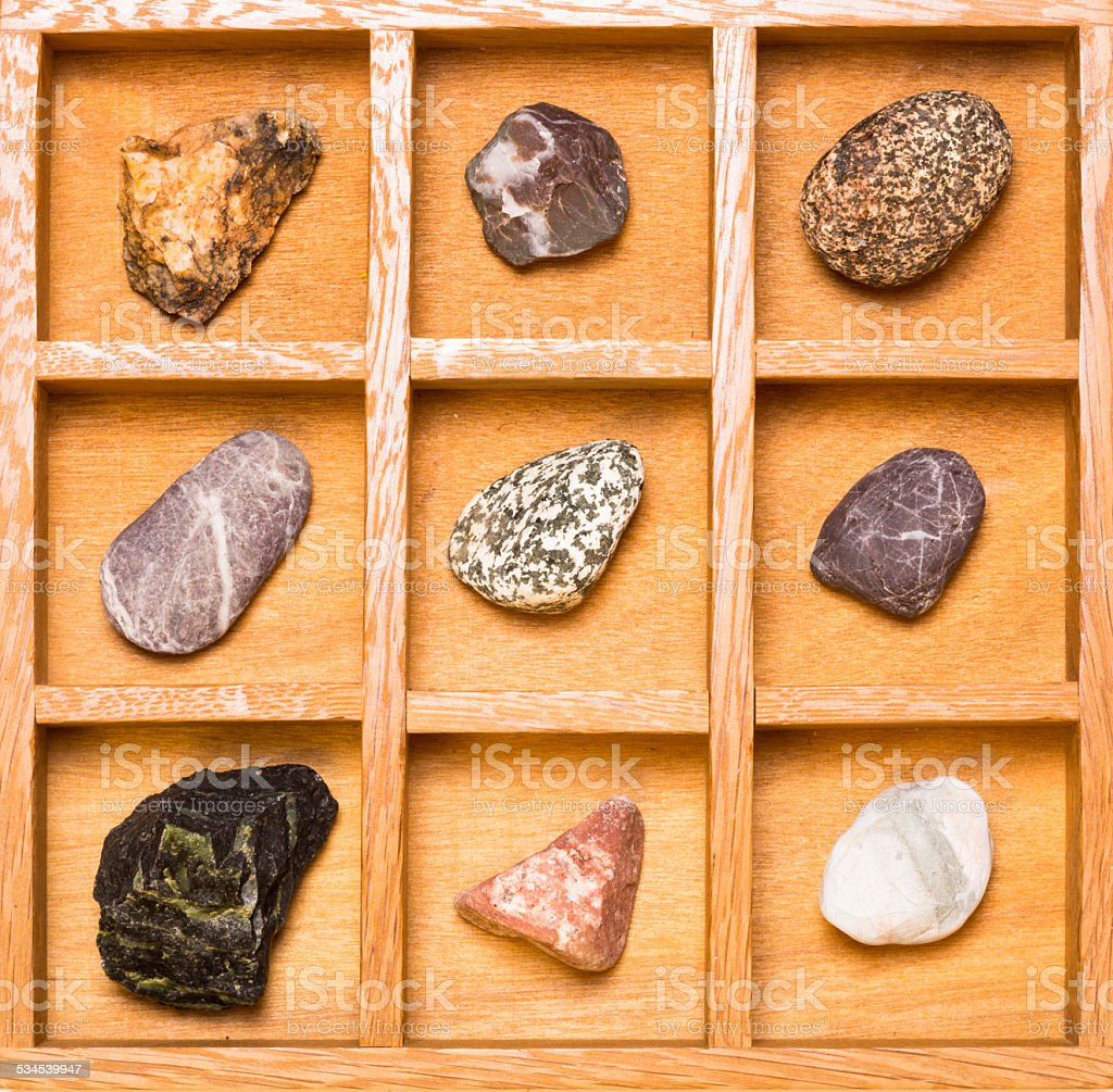 Shadow Box With Collection Of Rocks Stock Photo - Download