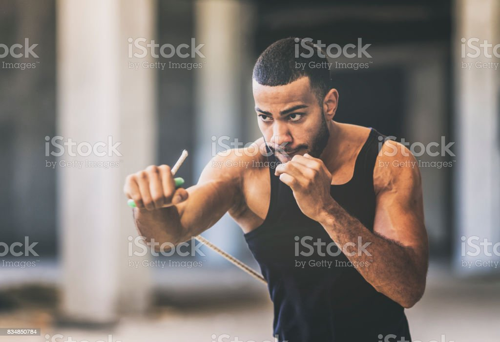 Shadow boxing in an urban gym stock photo & more pictures of