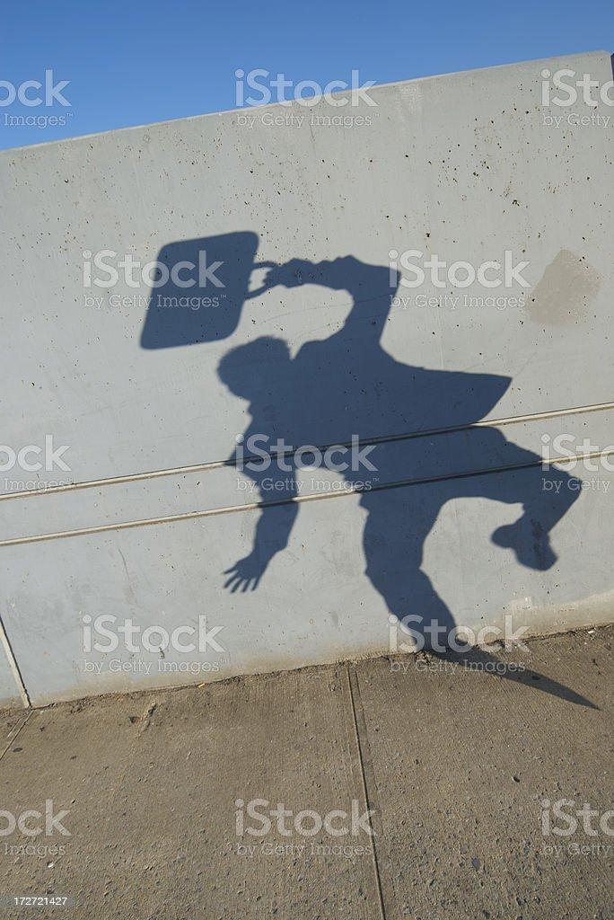 Shadow Businessman Jumps on Sidewalk royalty-free stock photo