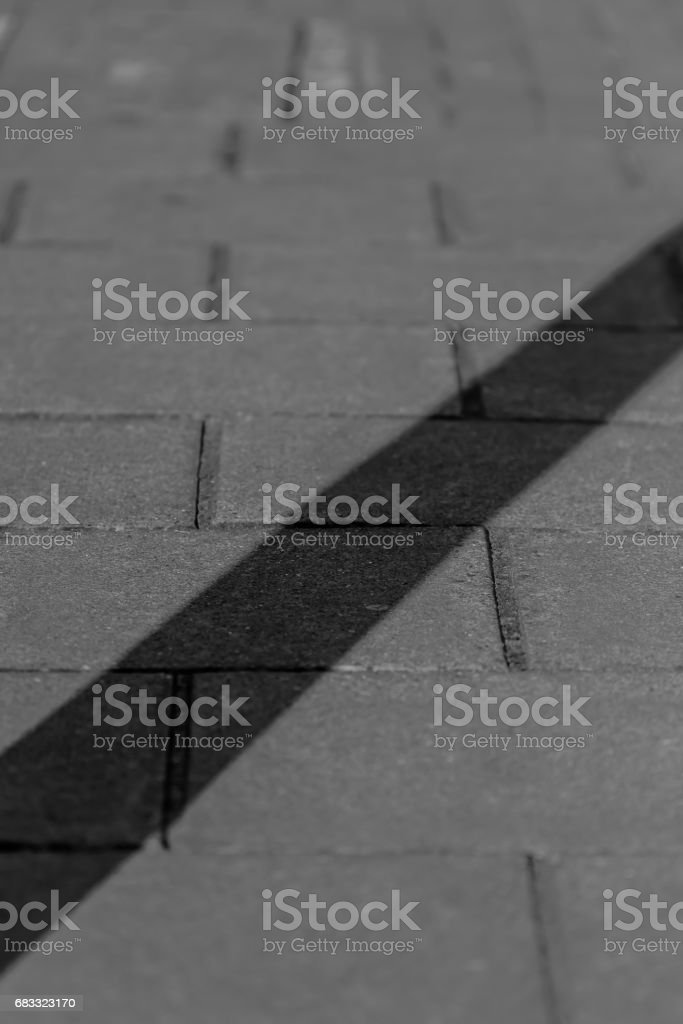 Shadow cast across sidewalk royalty-free stock photo