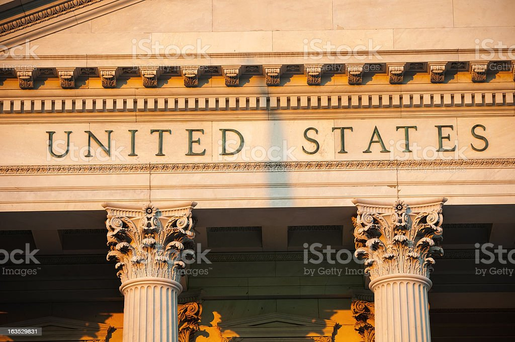 Shadow cast between United States on government building at sunset stock photo