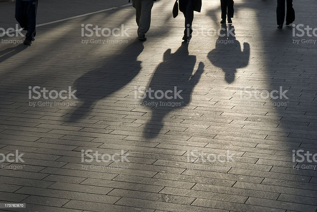 Shadow Commuters Businessmen Outdoors on Smooth Modern Walkway stock photo