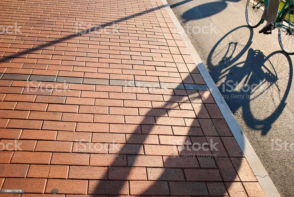 Shadow cyclists on track stock photo